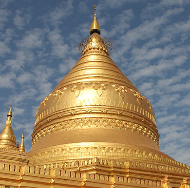 Theology, Religion and Philosophy image of the golden dome of a Burmese temple against a blue sky