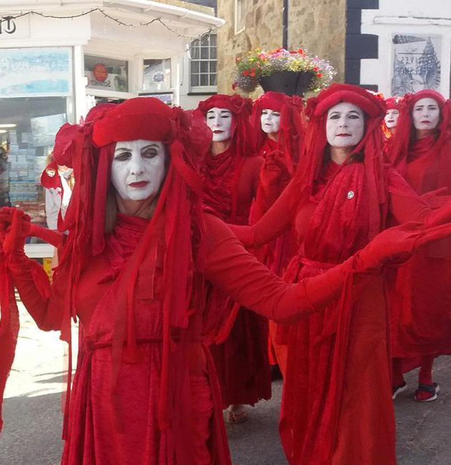 image of the Red Brigade protesting in St Ives