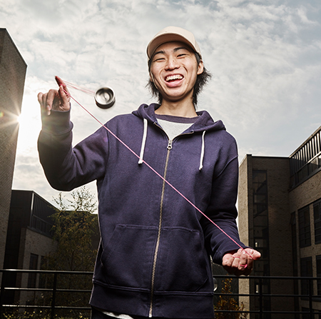 Student playing YoYo on campus